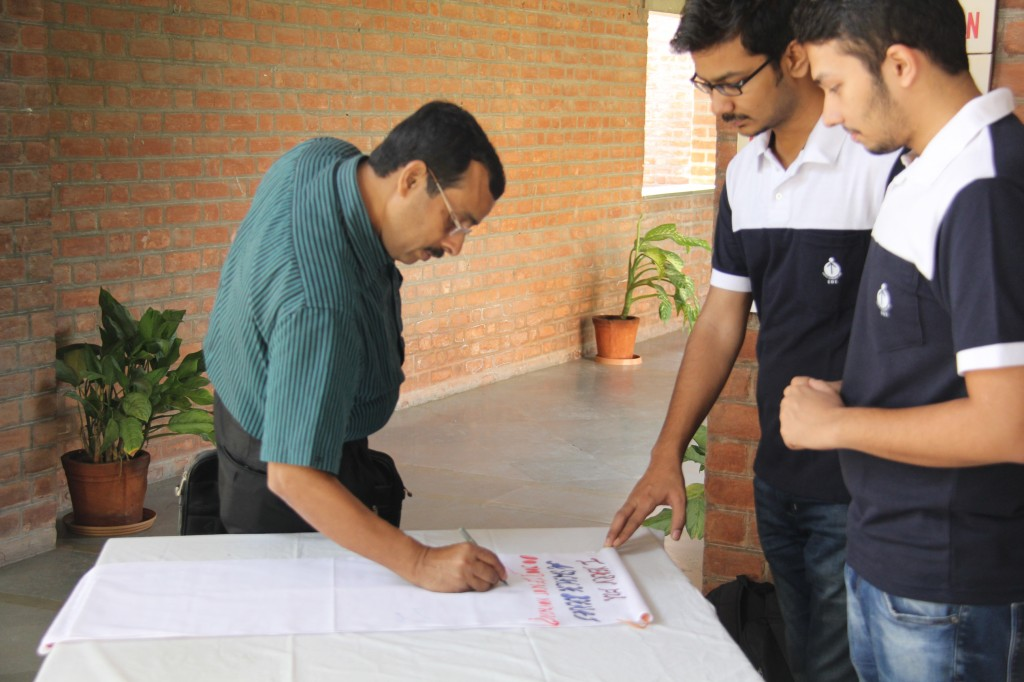 Prof. Sunil Shula, Chairperson PGPs, signing EDI Oath for Environmental Well-Being