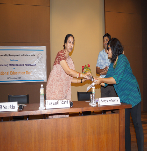 Ms. Priyanshi Jariwala, presenting a bouquet of flowers to Dr. Ravi