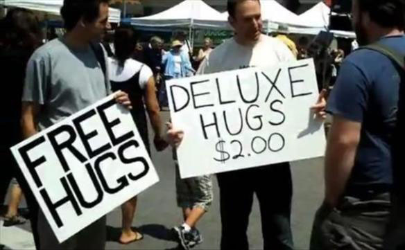 funny-picture-free-hugs-vs-deluxe-hugs